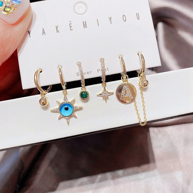 fashion star blue eyes letter ear buckle earring  NHCG363718