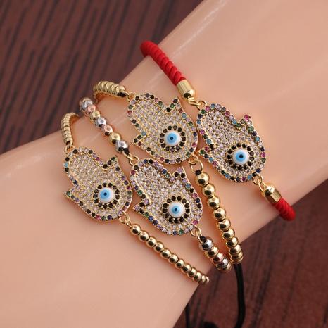 Retro copper micro-inlaid zircon devil eyes palm bracelet NHYL364275's discount tags