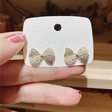 Pendientes de lazo de perlas de diamantes simples de Nihaojewelry, joyería al por mayor NHPA376456's discount tags