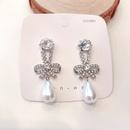Nihaojewelry Fashion Bowknot Pearl Tassel Stud Earrings Wholesale Jewelry NHHER376501