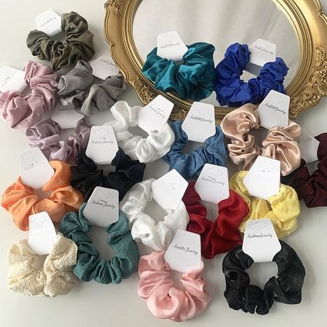 Al por mayor accesorios coleteros para el cabello de tela de color liso Nihaojewelry NHOF376972's discount tags