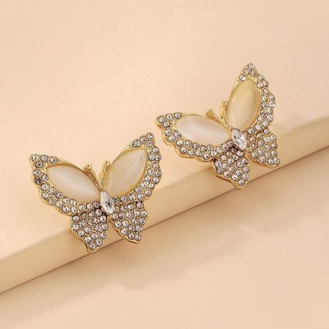 Nihaojewelry joyas al por mayor pendientes de mariposa de diamantes de imitación con incrustaciones de ópalo NHNJ376988's discount tags