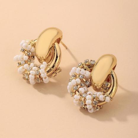 Nihaojewelry joyas al por mayor retro con incrustaciones de diamantes de imitación perla círculo sinuoso pendientes NHNJ376992's discount tags
