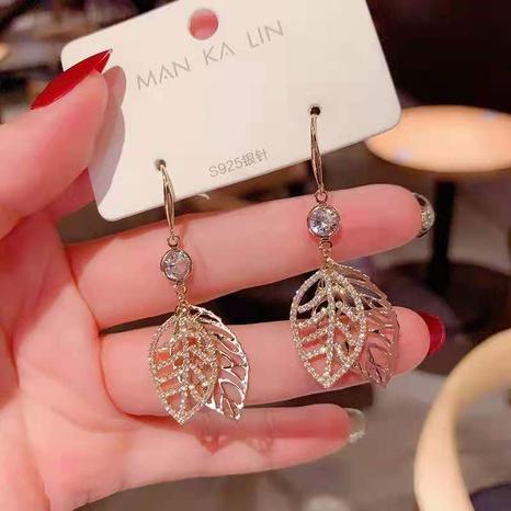 nihaojewelry pendientes de diamantes de imitación con incrustaciones de doble hoja hueca estilo coreano joyería al por mayor NHDQ377078's discount tags