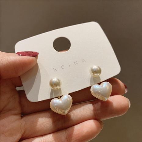WholesaleJewelry Pendientes de botón de perlas de corazón pequeño simple Nihaojewelry NHPA377159's discount tags
