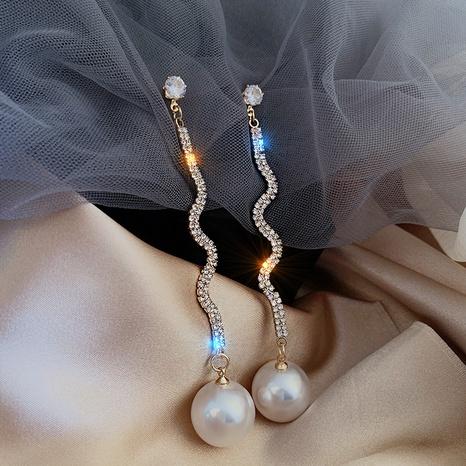 Nihaojewelry Pendientes largos de diamantes de imitación de perlas de estilo coreano Joyería al por mayor NHPA377189's discount tags