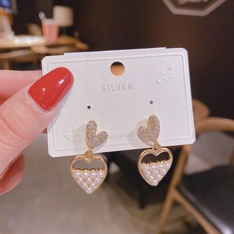 Pendientes de corazón de melocotón de diamante lleno de perlas de Nihaojewelry joyería al por mayor NHPA377190's discount tags
