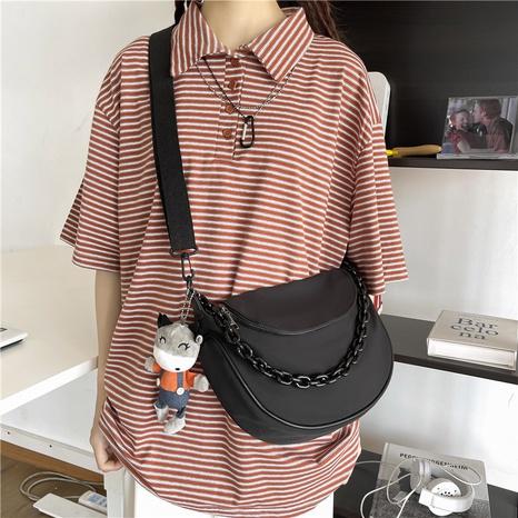 wholesale retro solid color black chain cartoon pendant messenger small bag nihaojewelry  NHAV382063's discount tags