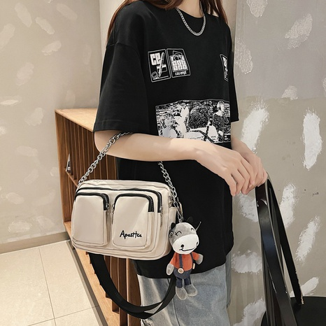 wholesale simple letter embroidery cartoon pendant messenger bag nihaojewelry  NHAV382066's discount tags