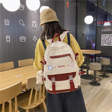 wholesale simple large capacity letter embroidery cartoon pendant backpack nihaojewelry  NHAV382074's discount tags