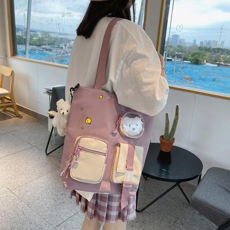 wholesale simple large-capacity cartoon doll pendant messenger canvas bag nihaojewelry  NHAV382085's discount tags