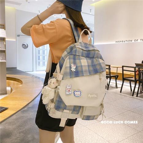 wholesale korean style plaid large-capacity cartoon pendant backpack nihaojewelry  NHAV382093's discount tags