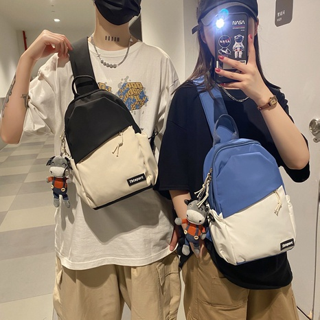 wholesale simple two-color matching cartoon pendant shoulder backpack nihaojewelry  NHAV382098's discount tags
