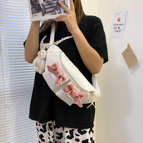 wholesale simple solid color bows messenger canvas bag nihaojewelry  NHAV382099's discount tags