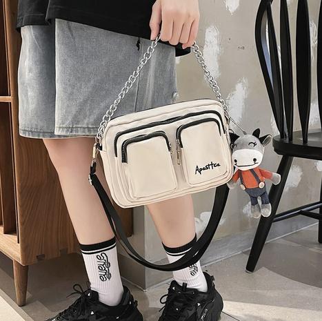 wholesale simple letter cartoon doll pendant shoulder messenger bag nihaojewelry  NHLH382283's discount tags