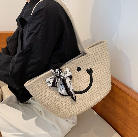 Nihaojewelry retro smiley straw woven bucket bag wholesale  NHLH382309's discount tags
