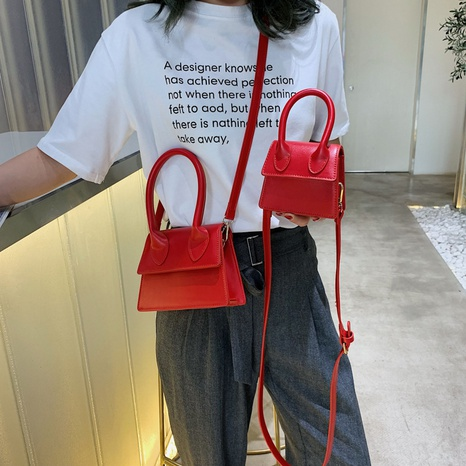 Nihaojewelry fashion solid color shoulder messenger portable bag wholesale NHLH382389's discount tags