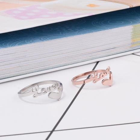 vente en gros bijoux lettre coeur bague en acier titane creux Nihaojewelry NHAB383109's discount tags