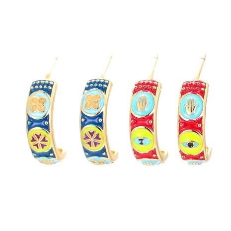 Nihaojewelry Retro Öltropfen Farbmuster Augen Blumen C-förmige Ohrringe Großhandel Schmuck NHWG383514's discount tags