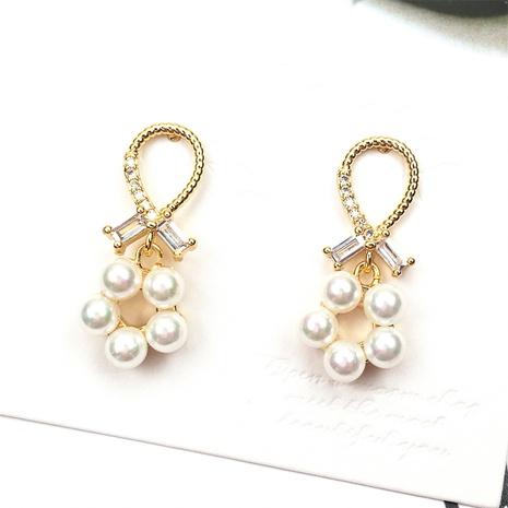 Nihaojewelry koreanischen Stil Kreuz Muschel Perle Zirkon Ohrringe Großhandel Schmuck NHPY383678's discount tags