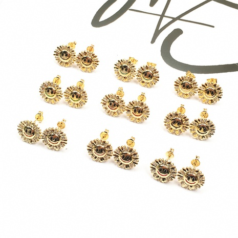 Großhandel Schmuck vergoldete Sonnenblume Smiley Tropfen Öl Ohrringe Nihaojewelry NHPY383687's discount tags
