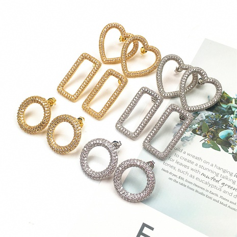 Nihaojewelry Mode Diamant Herzform geometrische hohle Ohrringe Großhandel Schmuck NHPY383690's discount tags