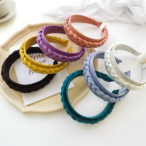 Nihaojewelry estilo coreano tela de color sólido trenzado diadema de ala ancha joyería al por mayor NHOF383709's discount tags