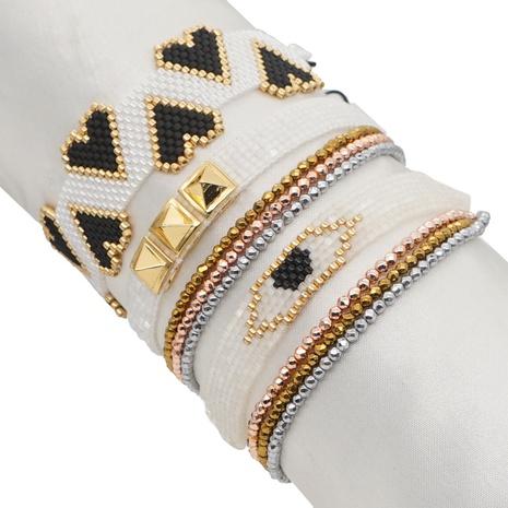 Nihaojewelry wholesale jewelry fashion devil's eye rivet Miyuki beads rose gold multi-layered bracelet NHGW383946's discount tags