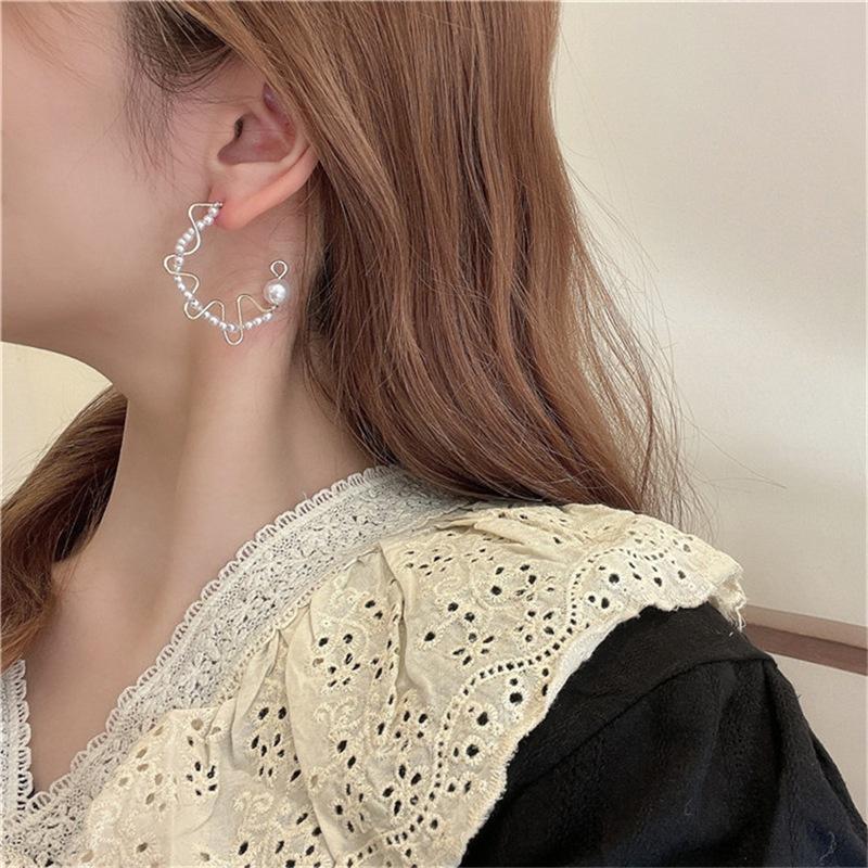 Nihaojewelry simple pearl semicircular earrings wholesale jewelry NHPA384172