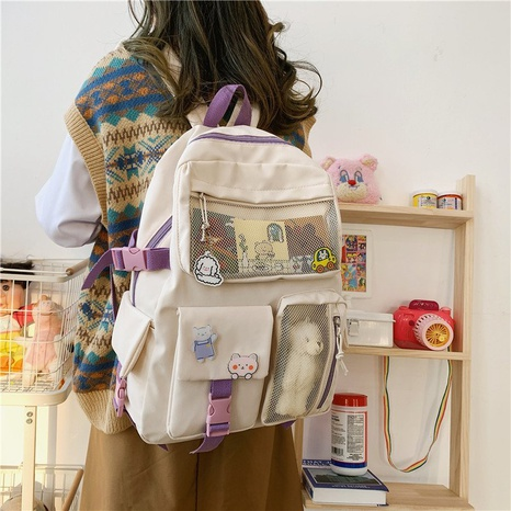 wholesale cartoon large capacity doll pendant backpack Nihaojewelry NHTG384236's discount tags