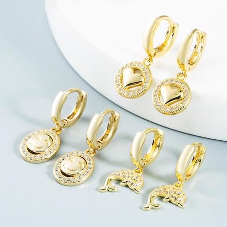 Nihaojewelry bijoux en gros simple sourire creux boucles d'oreilles coeur de dauphin boucles d'oreilles en zircon incrusté de cuivre NHYIS384777's discount tags