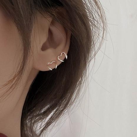 vente en gros bijoux simple coeur creux oreille en cuivre clip d'os Nihaojewelry NHBQ384962's discount tags