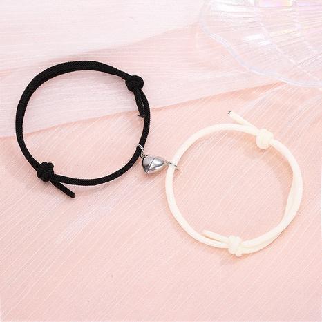 wholesale joyería simple imán del corazón de aleación que atrae el conjunto de pulsera Nihaojewelry NHZR385369's discount tags