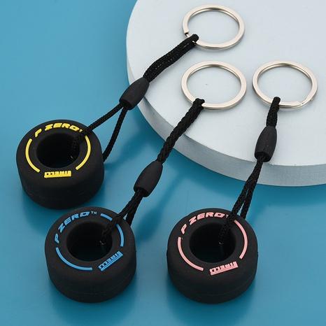 Vente en gros PVC porte-clés en caoutchouc souple pneu mignon pendentif clé de voiture porte-clés couple cartable pendentif NHWQ386103's discount tags