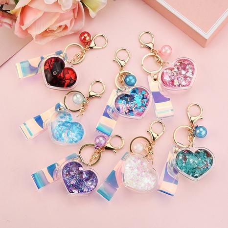 Acrylique dans la bouteille d'huile Quicksand Love Keychain en gros Glitter Peach Heart Car Key Chain Sac Accessoires NHWQ386099's discount tags