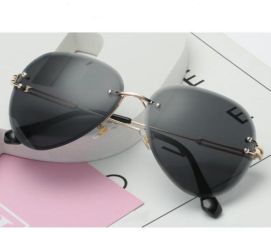 Vente en gros lunettes de soleil dégradées sans monture nihaojewelry NHZIH385423's discount tags