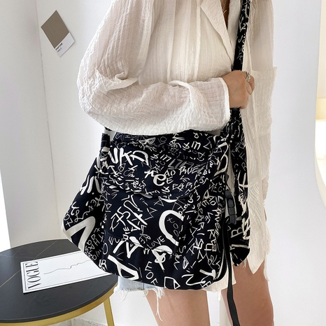 Nihaojewelry wholesale fashion graffiti one-shoulder messenger canvas bag NHWH386117's discount tags