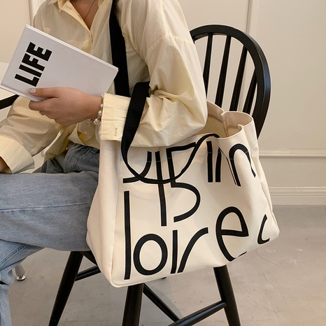 Nihaojewelry wholesale simple contrast color letter large-capacity canvas bag  NHAV386160's discount tags