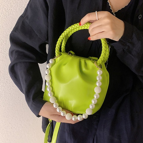 Nihaojewelry wholesale fashion beads handle solid color messenger bucket bag NHAV386207's discount tags