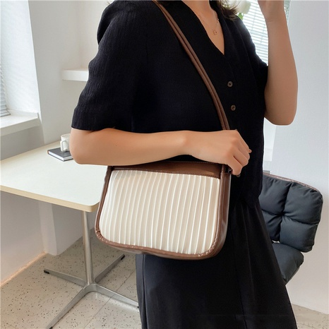 Nihaojewelry wholesale fashion vertical lines contrast color cross-body bag NHWH386124's discount tags