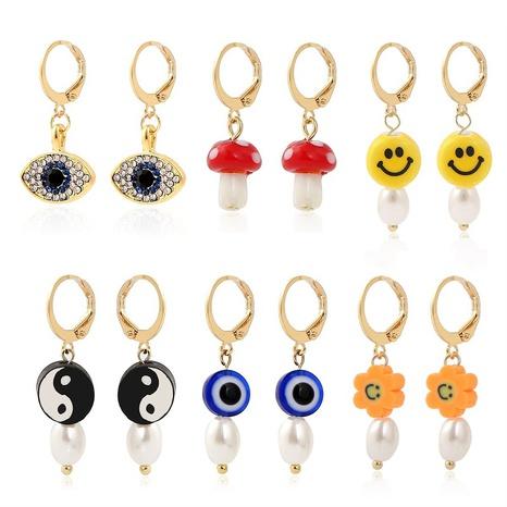 Großhandel Tai Chi Smiley-Gesicht Ohrringe Teufelsaugen-Pilz-weiche Keramik-Ohrstecker NHQC387335's discount tags