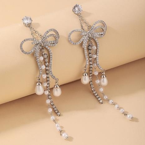 Nihaojewelry Großhandel Schmuck Mode Perle mit Strasssteinen lange Schleife Quaste Ohrringe eingelegt NHNJ387352's discount tags