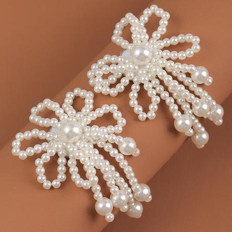 Nihaojewelry Großhandel Schmuck einfache handgewebte Blumenperlenohrringe NHLA387415's discount tags