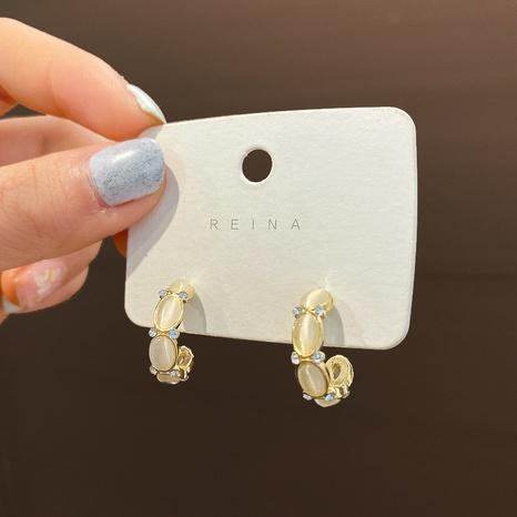 Großhandel Schmuck Opal C-förmige Modeohrringe Nihaojewelry NHQIY387805's discount tags