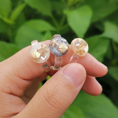 anillo de diamante de estrella de mar de concha de resina transparente joyería al por mayor Nihaojewelry NHYIA389732's discount tags