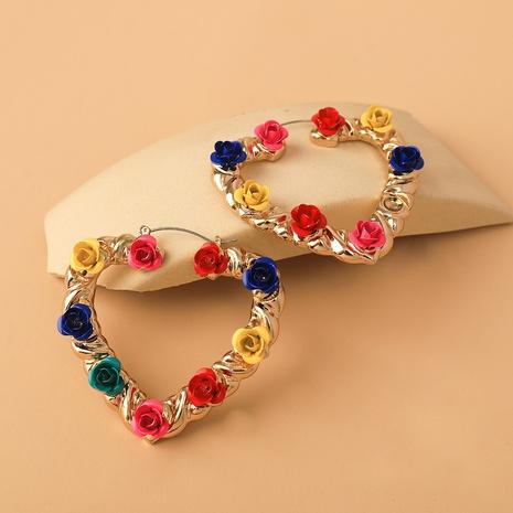 Al por mayor joyas pendientes de flores huecas en forma de corazón nihaojewelry NHYIA389735's discount tags