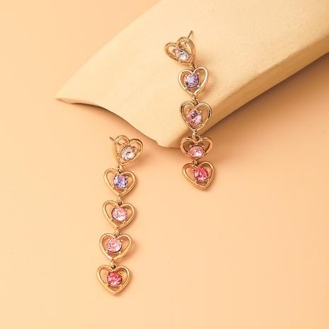 wholesale joyas pendientes colgantes de diamantes en forma de corazón huecos multicolores nihaojewelry NHYIA389743's discount tags