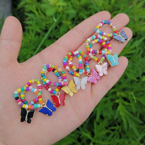 Al por mayor joyería de perlas de arroz anillo de mariposa elástico Nihaojewelry NHYIA389765's discount tags
