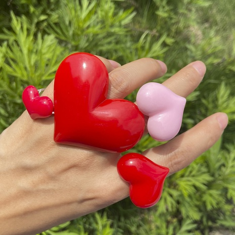 Al por mayor joyería anillo de resina de corazón de color sólido Nihaojewelry NHYIA389775's discount tags