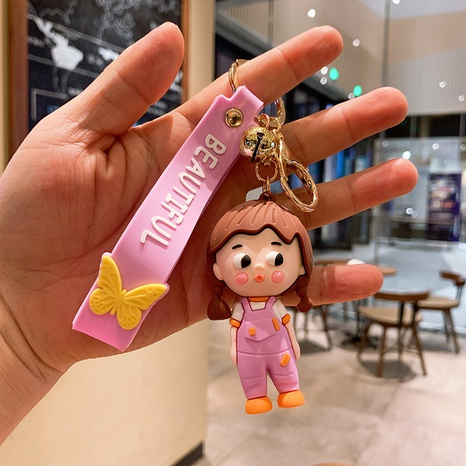 Großhandel Cartoon schmollendes Mädchen Silikon Schlüsselanhänger Nihaojewelry NHQYF390406's discount tags